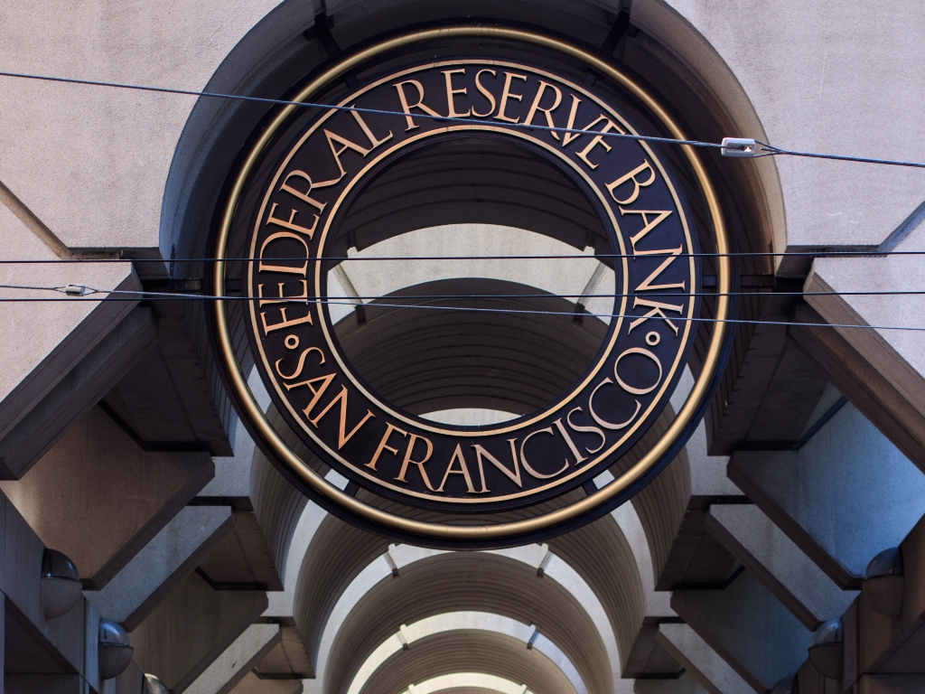 The sign outside the San Francisco Federal Reserve Bank with a black background and gold letters