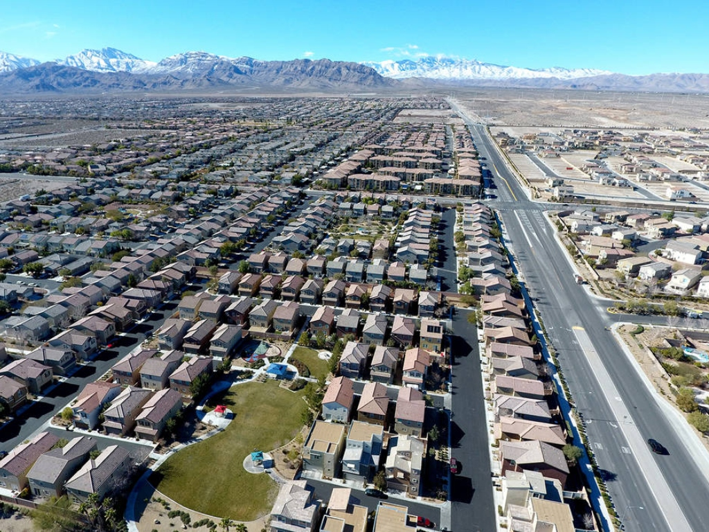 An aerial view of the Las Vegas sprawl with mountains in the background